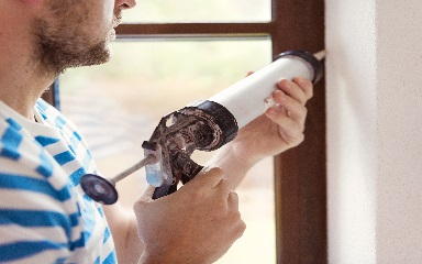 Guy with caulking gun