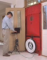 Photo of a man conducting a blower door test