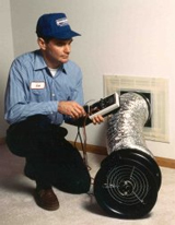 Photo of a man conducting a duct blaster test