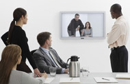 four office workers videoconferencing