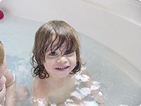 Toddler in bath tub