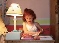 photo of child studying at a desk