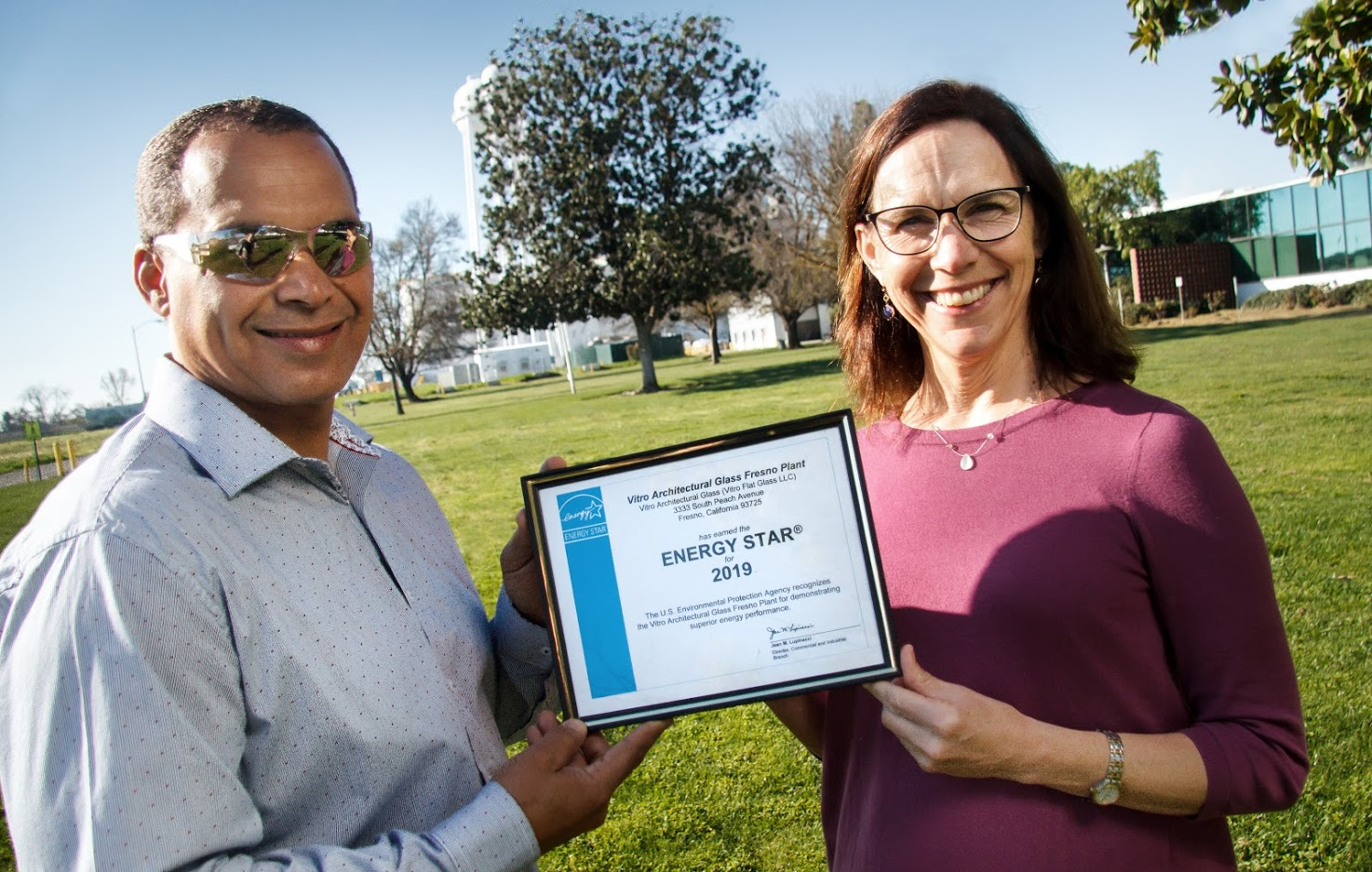 Vitro Glass Fresno, CA staff holding ENERGY STAR certificate