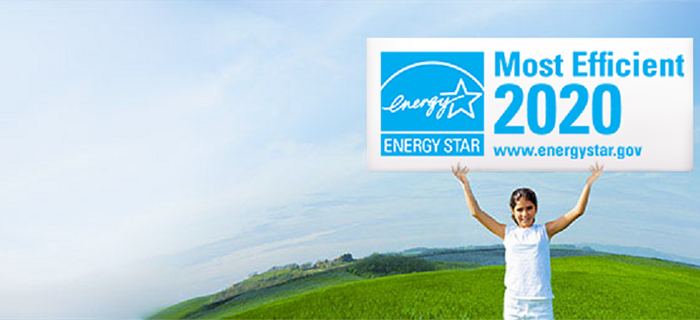 girl holding energy star most efficient 2020 sign