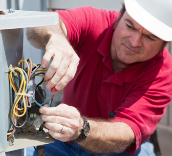 A professional contractor working on an HVAC system.