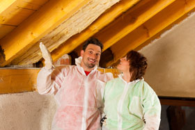 couple installing insulation
