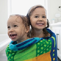 Water Heater promo image - kids wrapped in a towel