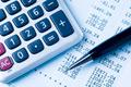 Image a calculator, pen and spreadsheet