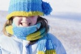 Girl in blue hat in winter