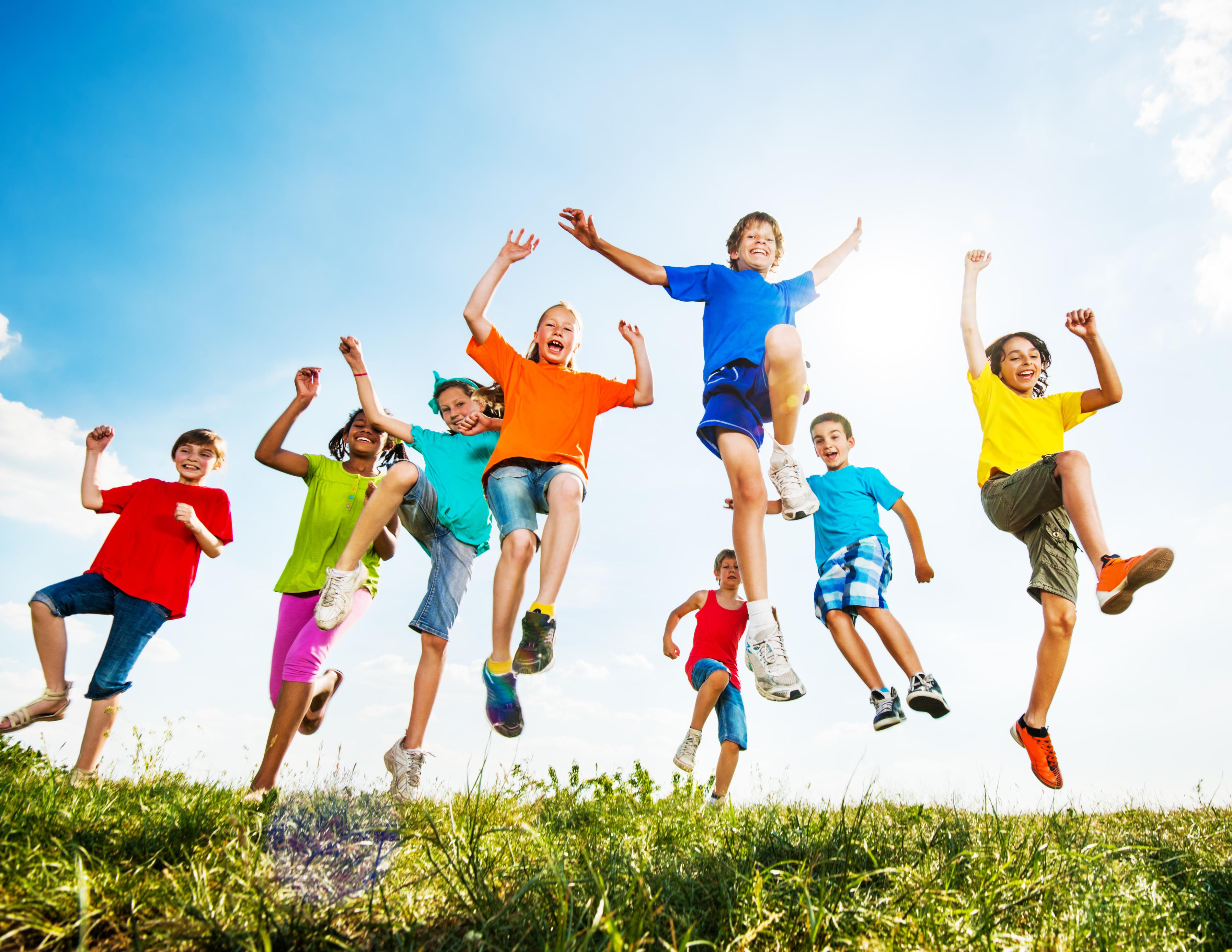 Kids jumping in a field