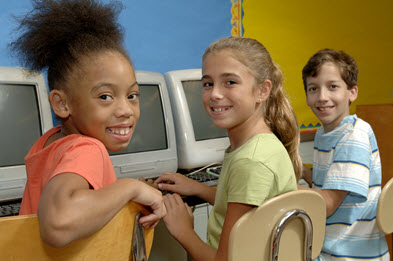 Kids sitting in front of computers