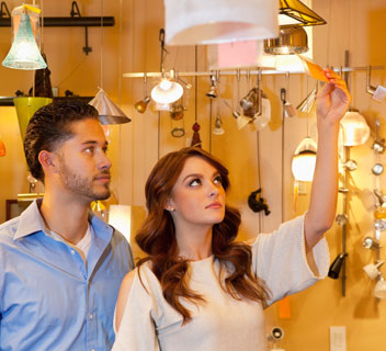Couple shopping for lighting
