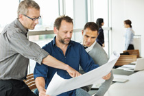 Photo of people looking at a design plan.