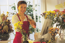 Photo of a woman selling flowers.