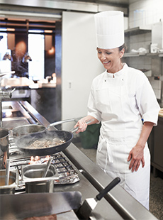 A chef cooking in a commercial kitchen