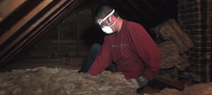 photo of a man insulating an attic