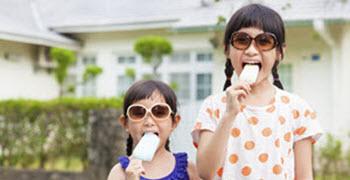 Two children eating ice cream