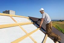 image of a man working on a roof