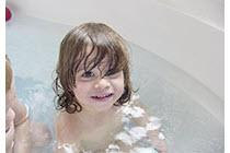 child bathing in a tub