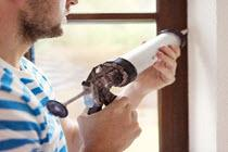 man with a caulking gun
