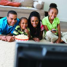 Image of family watching television