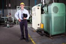 Image of a man in an industrial building to evaluate energy performance.