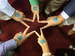 hands with ENERGY STAR temporary tattoos forming a star